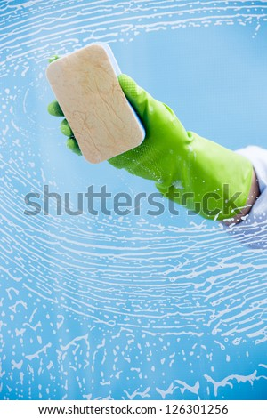 Cleaning - cleaning  pane with detergent, spring cleaning concept - stock photo