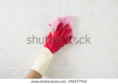 Cleaning - cleaning window pane with detergent, spring cleaning concept  - stock photo