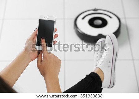 Cleaning concept - automatic robotic hoover clean the room, close up - stock photo