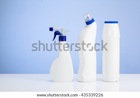 Cleaning concept background. Assorted products isolated on white and blue backdrop. Studio product shot for advertising, website or blog. - stock photo