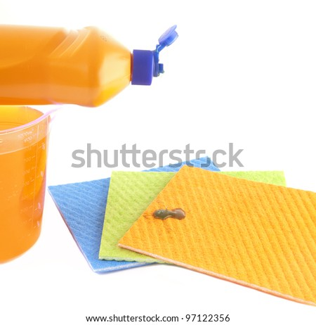 Cleaning concept. Dish washing liquid and sponges. - stock photo