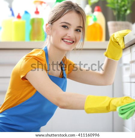 Cleaning concept. Woman washes an oven, close up - stock photo