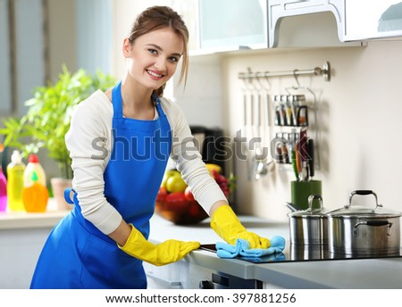 Cleaning concept. Woman washes an oven in the kitchen - stock photo