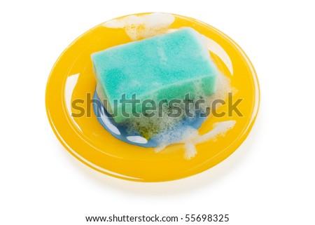 Cleaning dishware kitchen sink sponge washing dish - stock photo