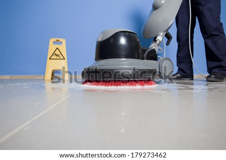 cleaning floor with machine - stock photo