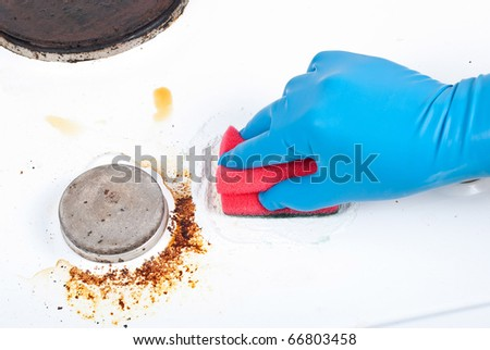 Cleaning gas glove kitchen - stock photo
