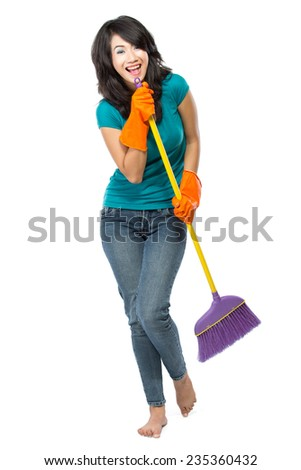 Cleaning girl happy excited during cleaning. Funny girl with cleaning mop playing guitar isolated on white background - stock photo