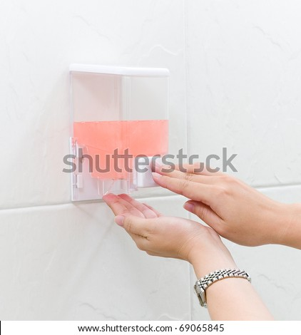 Cleaning hand gel in a box ready to use by pumping the image isolated - stock photo