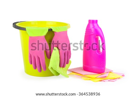Cleaning items and bucket isolated on white background. Purple and green glove and green towel and bucket. Purple bottle.