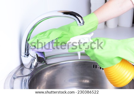 Cleaning kitchen sink close-up - stock photo