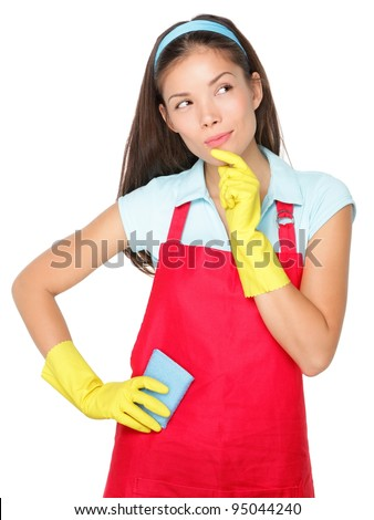 Cleaning lady thinking isolated on white background. Beautiful young mixed race Caucasian / Chinese Asian cleaning woman looking at copy space pensive. - stock photo