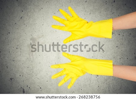 Cleaning. Latex Glove Making OK sign - stock photo