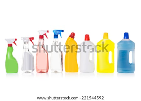 Cleaning liquid bottles in row. Isolated on white