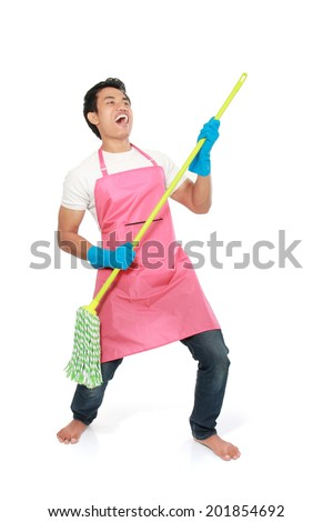 Cleaning man happy excited during cleaning. Funny man with cleaning mop playing guitar isolated on white background - stock photo