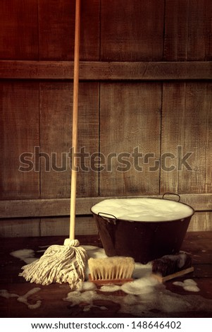 Cleaning mop and bucket with wet soapy floor - stock photo