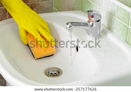 cleaning of dirt white washstand faucet in bathroom