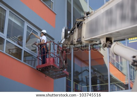 Cleaning of windows from outside - stock photo