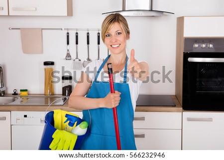 Closeup Man Cleaning Floor Yellow Wet Stock Photo