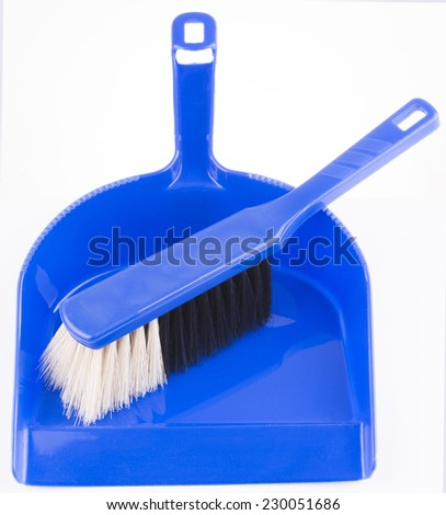 Cleaning set of dust-pan and brush on isolated background