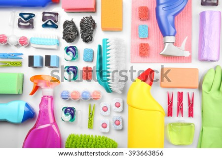 Cleaning set with products and tools on white background