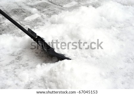 Cleaning snow with a shovel - stock photo