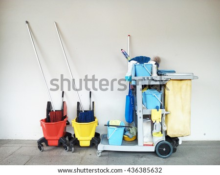 Cleaning Supplies,Commercial cleaning equipment with cart,Professional Cleaning Equipment as mop, bucket, glove, cart - stock photo