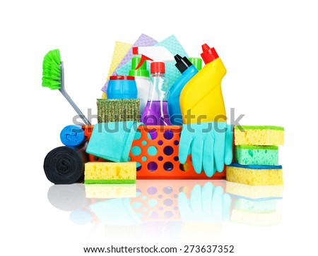 Cleaning supplies in a basket - cleaning and housekeeping concept