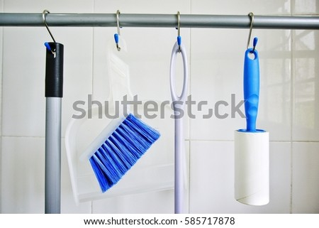 Cleaning Supply Storage Hanging On S Hooks   Concept.