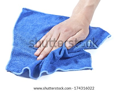 Cleaning surface with a microfiber cloth - stock photo
