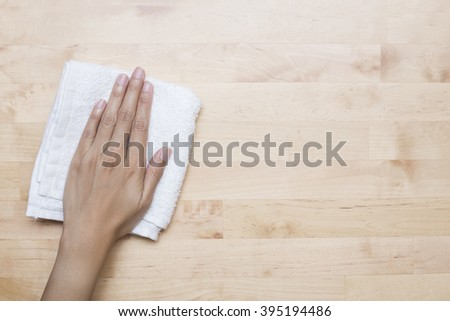 Cleaning table by woman hand - stock photo