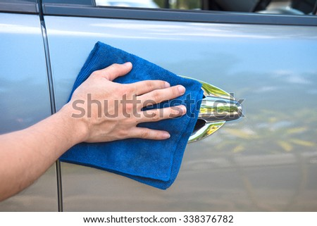 Cleaning the  car with microfiber cloth and wax coating  - stock photo