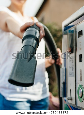 Cleaning car woman holding showing vacuum stock photo 750433672 cleaning the car woman holding showing vacuum cleaner hose at modern self car wash station solutioingenieria Images