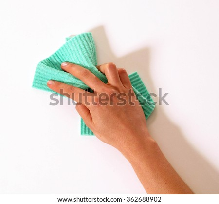Cleaning the wall with the cleaning sponge tool. - stock photo