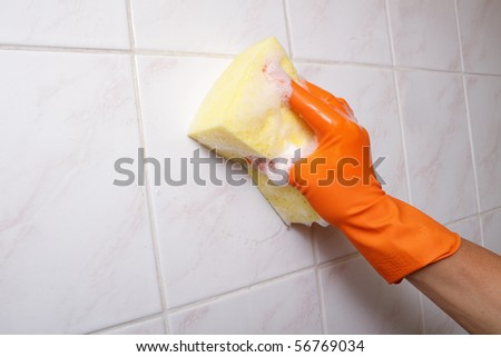 Cleaning tiles. - stock photo