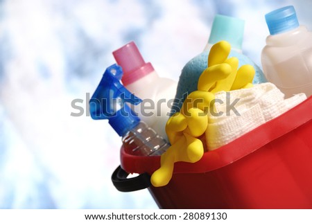 cleaning tools over a blue sky background - stock photo