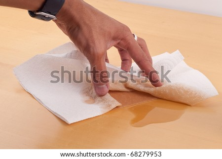 Cleaning Up a Spill with Absorbent Paper Towel - stock photo