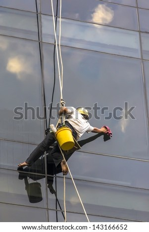 Cleaning windows glass - stock photo