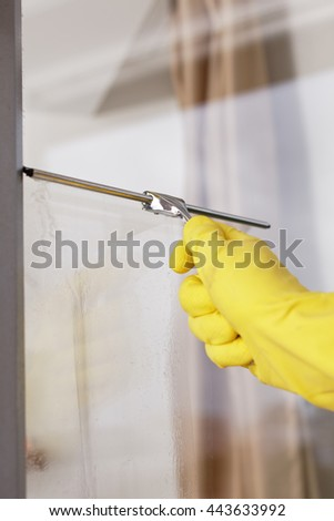Cleaning windows using window squeegee