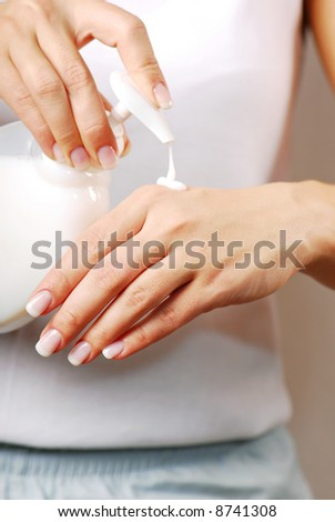 Cleaning - Woman press the liquid soap on hands.