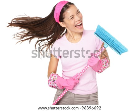 Cleaning woman singing having fun during spring cleaning. Funny woman cleaning wearing pink rubber gloves singing into broom. Mixed race Caucasian / Asian female model isolated on white background. - stock photo
