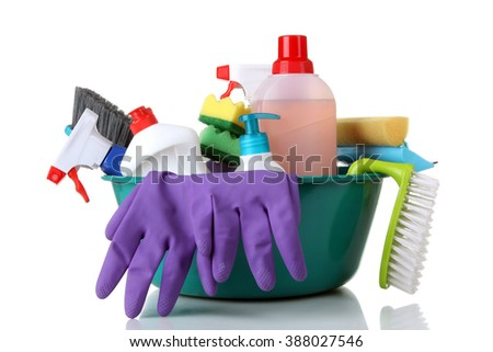 cleanser brush and rubber gloves in a large plastic bowl on white isolated background