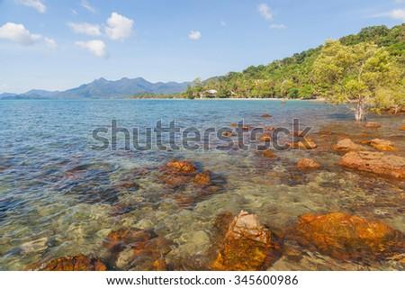 Clear blue sea with backmountain, Thailand - stock photo