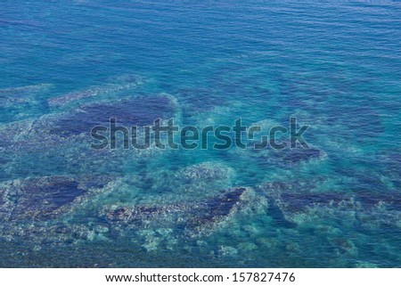 clear blue sea with stone reefs