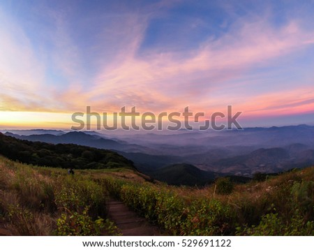 Clear blue sky above mountain on sunset