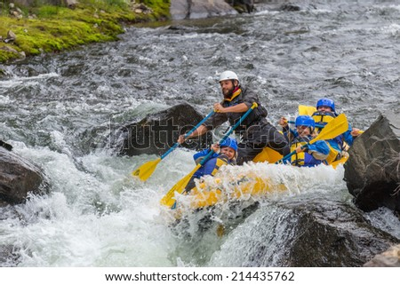 CLEAR CREEK, COLORADO/U.S.A. - August 31, 2014: Late season white water rafting adventure continues on the Clear Creek River just 30 minutes from Denver on August 31, 2014 in Clear Creek, Colorado. - stock photo
