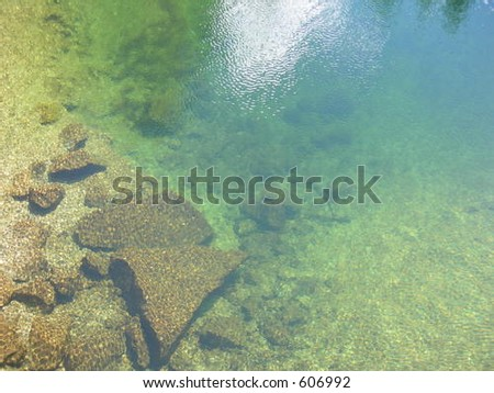 Clear creek with rocks - stock photo