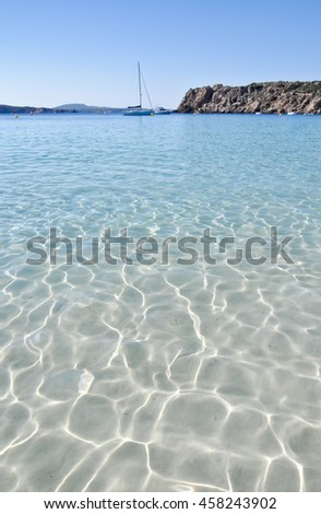 Clear, crystal water on the Arenal den Castell beach, Minorca, Spain - stock photo