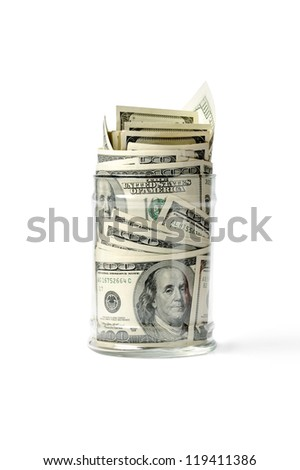 Clear glass jar with money isolated on white - stock photo