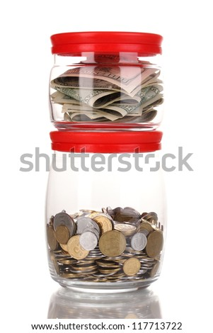Clear glass jars for tips with money isolated on white - stock photo