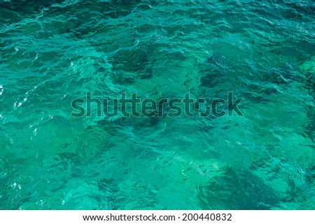 Clear green wavy sea water texture background - stock photo